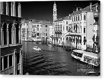 Speed Boat On The Grand Canal Canvas Print by John Rizzuto