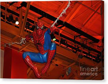 Toy Store Canvas Print - Spiderman Swinging Through The Air by John Telfer