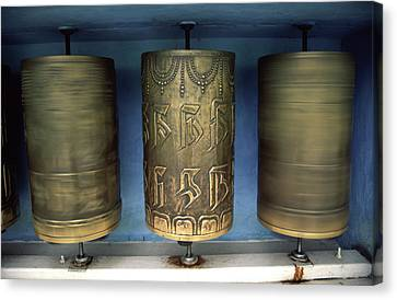 Tibetan Canvas Print - Spinning Prayer Wheels Is Said To Send by Paul Dymond