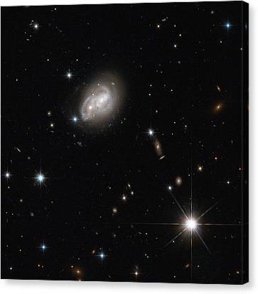 Spiral Galaxies Interacting Canvas Print by Science Source