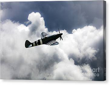 Spitfire Cloudy Skies  Canvas Print by J Biggadike