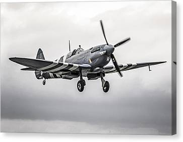 Spitfire Coming Home Canvas Print by Chris Smith