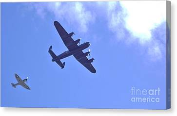 Canvas Print featuring the photograph Spitfire  Lancaster Bomber by John Williams