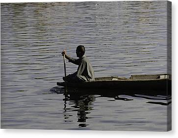 Splashing In The Water Caused Due To Kashmiri Man Rowing A Small Boat Canvas Print by Ashish Agarwal