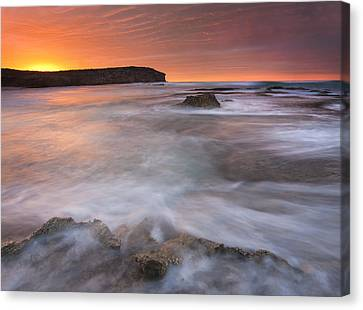 Splitting The Tides Canvas Print by Mike  Dawson