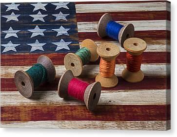 Spools Of Thread On Folk Art Flag Canvas Print by Garry Gay