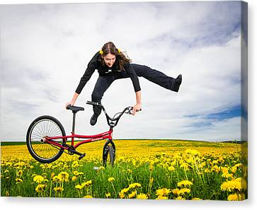 Spring Has Sprung - Bmx Flatland Artist Monika Hinz Jumping In Yellow Flower Meadow Canvas Print by Matthias Hauser