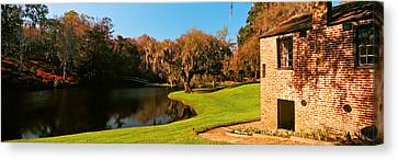 Springhouse And Chapel In A Garden Canvas Print by Panoramic Images