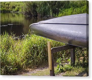 Springtime Canoe Canvas Print by Carolyn Marshall
