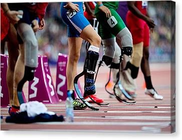 Sprinter Canvas Print - Sprinters At Start Of Paralympics 100m by Science Photo Library