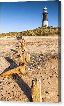 Spurn Point Lighthouse And Sea Defences Canvas Print by Colin and Linda McKie