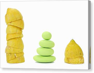 Squeezed Yellow Citrus And Pebbles Canvas Print by Sami Sarkis