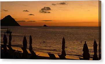 Canvas Print featuring the photograph St. Lucia - Sundown - Closed Umbrellas by Nora Boghossian