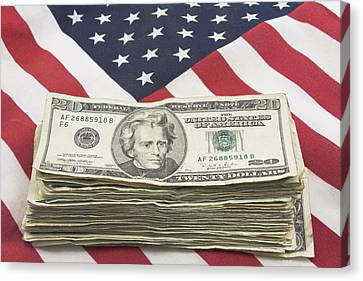 Stack Of Money On American Flag  Canvas Print