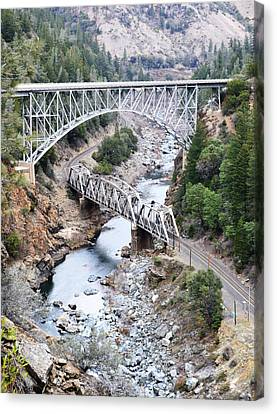 Stacked Bridges Canvas Print by Holly Blunkall