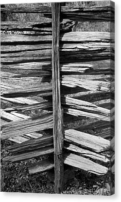 Stacked Fence Canvas Print by Lynn Palmer