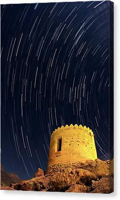 Star Trails Over Ancient Watchtower Canvas Print by Babak Tafreshi