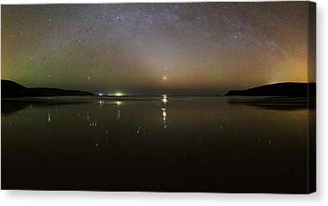 Starlight Reflected In A Bay At Night Canvas Print by Laurent Laveder