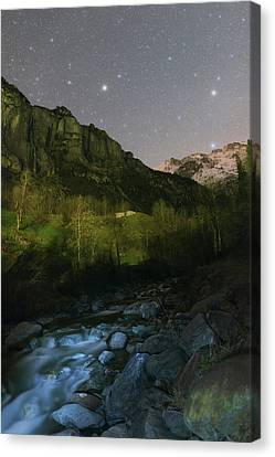 Snowy Night Night Canvas Print - Stars Over Lauterbrunnen by Babak Tafreshi