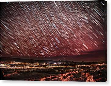 Stars Screaming Over The Desert Canvas Print by Noah Katz