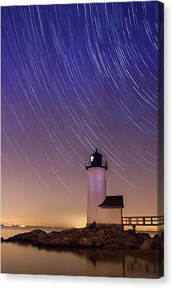 Canvas Print featuring the photograph Stars Trailing Over Lighthouse by Jeff Folger