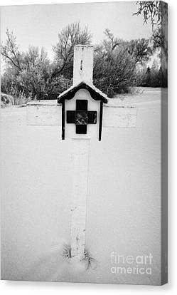 stations of the cross in a graveyard during winter in Forget Saskatchewan Canvas Print by Joe Fox
