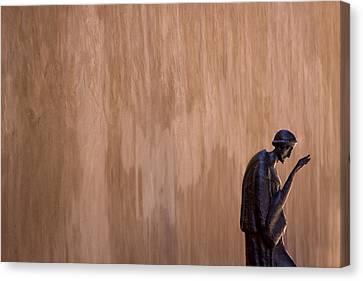 Statue Against Adobe Wall Santa Fe Canvas Print