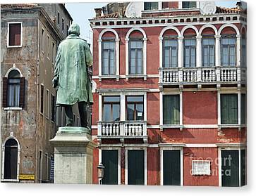 Statue And Building Facade Canvas Print by Sami Sarkis