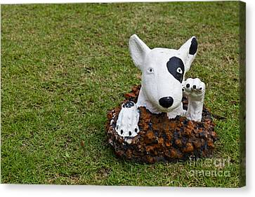 Statue Of A Dog Decorated On The Lawn Canvas Print
