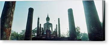 Statue Of Buddha At A Temple, Sukhothai Canvas Print by Panoramic Images
