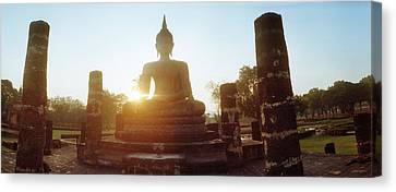 Statue Of Buddha At Sunset, Sukhothai Canvas Print by Panoramic Images