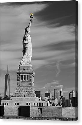 Statue Of Liberty And The Freedom Tower Canvas Print by Dan Sproul
