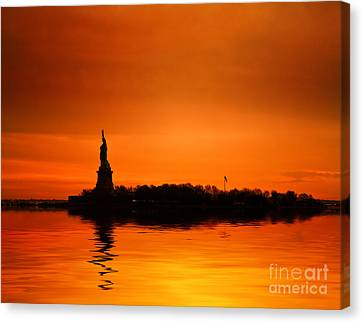 Statue Of Liberty At Sunset Canvas Print by John Farnan