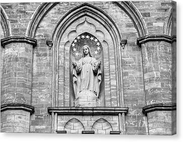 Heritage Montreal Canvas Print - Statue On Facade Of Notre Dame Church by David Chapman