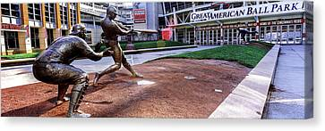 Statues Of Baseball Players Canvas Print by Panoramic Images