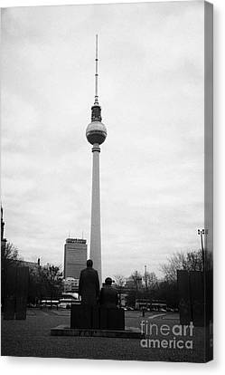 statues of Marx and Engels in the Marx Engels Forum looking at the berliner fernsehturm Berlin TV tower symbol of east berlin Germany Canvas Print