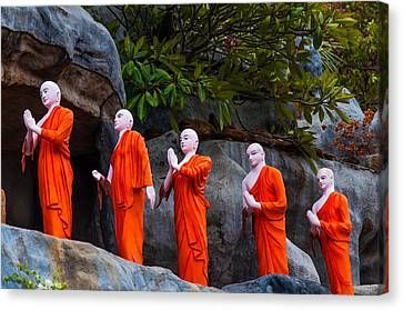 Statues Of The Buddhist Monks At Golden Temple Canvas Print by Jenny Rainbow