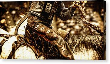 Staying In The Saddle Canvas Print by Lincoln Rogers