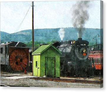 Steam Locomotive Coming Into Train Yard Canvas Print by Susan Savad