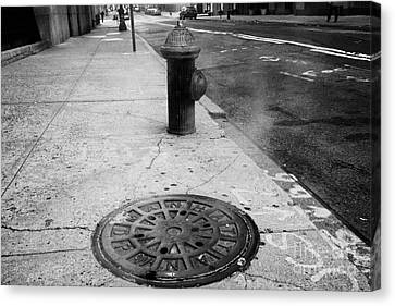 Steam Rising From Dpw Manhole Cover On Sidewalk With Old Fashioned Fire Hydrant New York City Canvas Print by Joe Fox
