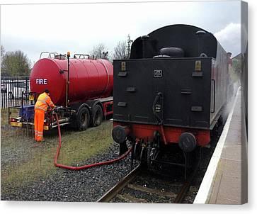 Steam Train Water Refill Canvas Print by Cordelia Molloy
