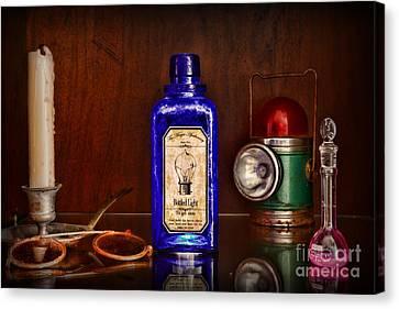 Steampunk Bottled Light Canvas Print by Paul Ward
