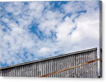 Steel And Sky Canvas Print by Peter Tellone