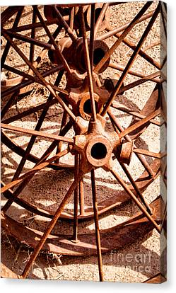 Steel Spokes Canvas Print by Lawrence Burry