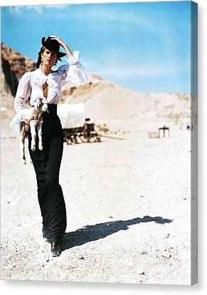 Stella Tennant Carrying A Lamb Canvas Print