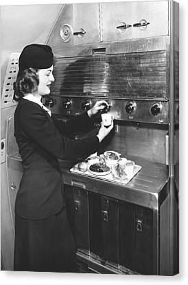 Stewardess Preparing Dinner Canvas Print by Underwood Archives