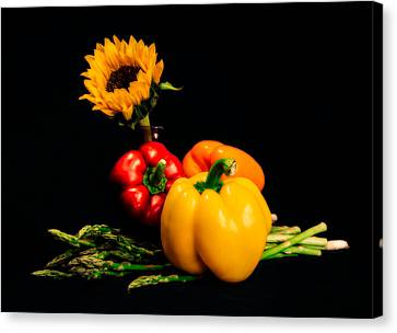 Still Life Peppers Asparagus Sunflower Canvas Print by Jon Woodhams