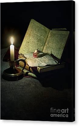 Still Life With A Candle Canvas Print by Jaroslaw Blaminsky