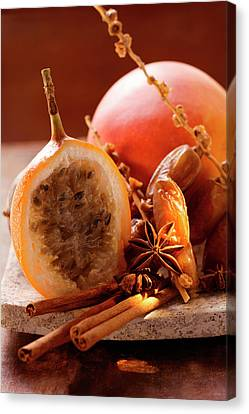 Passionfruit Canvas Print - Still Life With Dates, Star Anise, Cinnamon, Granadilla And Mango by Foodcollection