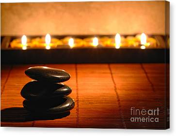 Canvas Print featuring the photograph Stone Cairn And Candles For Quiet Meditation by Olivier Le Queinec